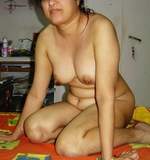 Hot Pics Of A Booby Mallu Aunty Showing Tits Pussy And Ass Shot By